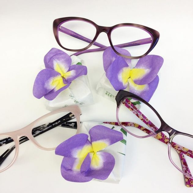 Photo of flowers and Coach and Lafont eyeglasses