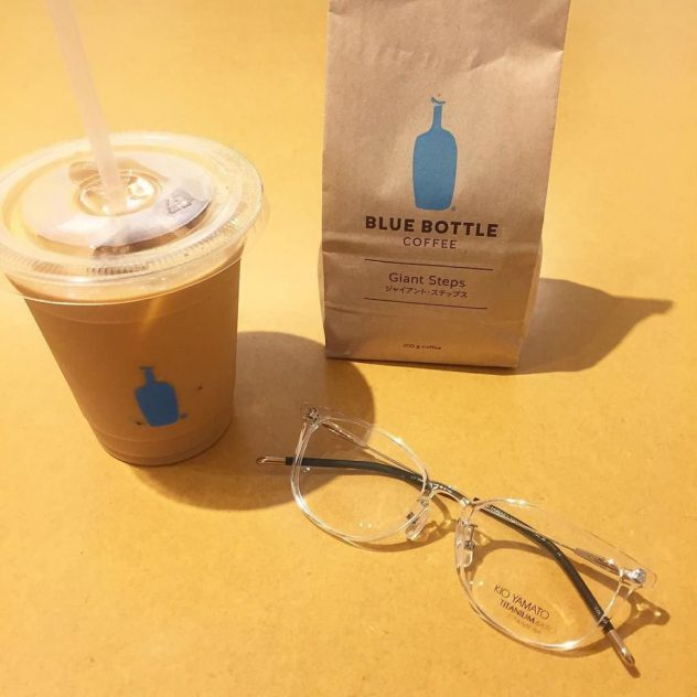 A photo of Kio Yamato eyeglasses and a cup of Blue Bottle Coffee.