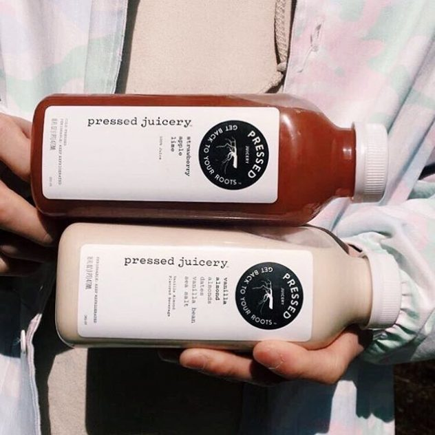 Two bottle of Pressed Juicery , Strawberry apple and Vanilla Almond juice.