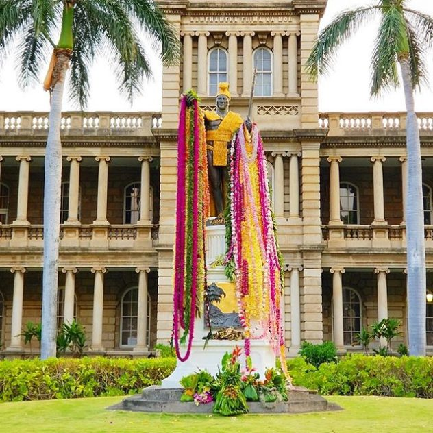 Photo of King Kamhameha statue draped in lei.