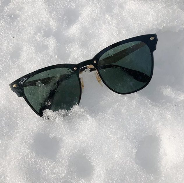 Ray Ban sunglasses on snow.