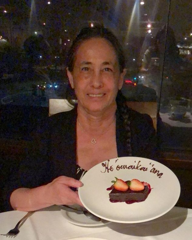 Norma holding her retirement dessert